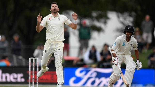 Bad light halts England